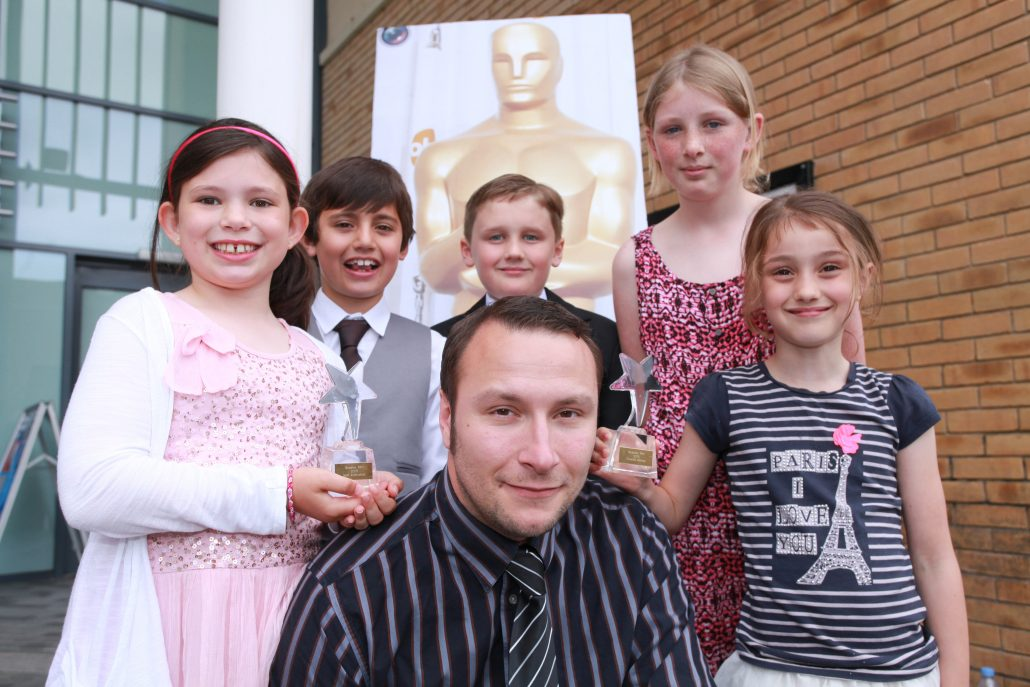 Bicester Schools Film Festival sponsored by Countryside Properties (Bicester) Ltd, the developer of Kingsmere - 2/7/15  Overall winners from Langford Village School Rosmary Early, James Durbin, Skulah Walton, Kerry Stanley and Matthew Oke pictured with Scott Young.